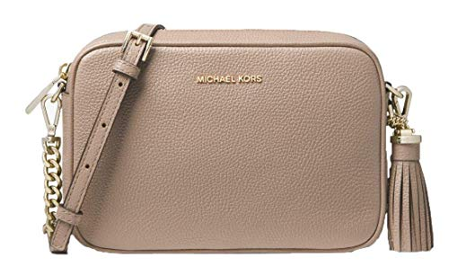 Main compartment and interior pocket Zip top closure Internal plate with hot-stamped Michael Kors logo Adjustable and removable shoulder strap Decorative tassel on the side