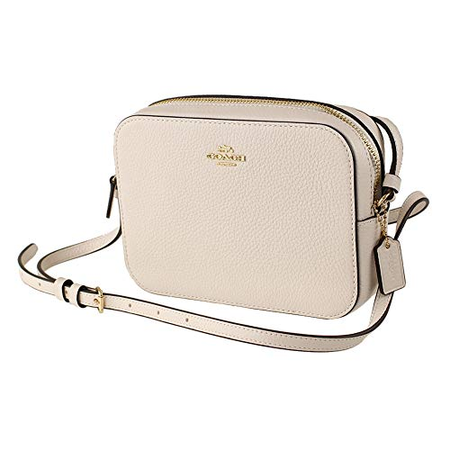 "Refined pebble leather with gold tone hardware Two credit card slots ,Inside multifunction pocket Zip closure, fabric lining, outside open pocket Adjustable strap with 23"" drop for shoulder or crossbody wear Approximate dimensions: 7.25""L x 5.25""H x ..."