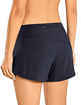 CRZ YOGA Women s Quick-Dry Athletic Sports Running Workout Shorts with Zip Pocket - 4 Inches Navy 4  -R403 Medium