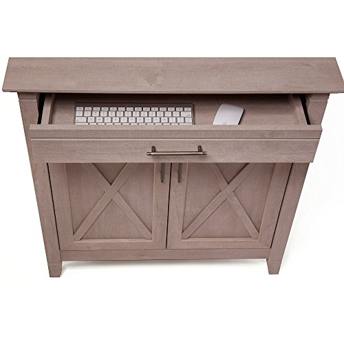 a storage cabinet with secret laptop tray is a great work from home solution for small spaces