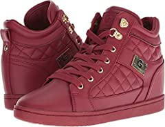 Let your steez shine with the G by GUESS® Dayna sneaker. Faux-leather upper. Lace-up closure. Brand logo detail at tongue and side. Round-toe design with stitch detail. Soft fabric lining and footbed. Leather and rubber outsole. Imported. Measurement...