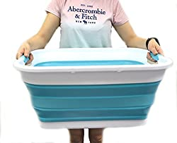 person holding collapsible laundry basket