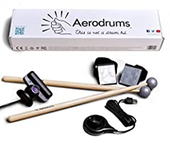 "Two drum sticks with reflective balls Two foam triangles with elastic loops: the ""foot markers"" A donut shaped lamp with a lens and a USB plug: the ""lamp"" Sony PlayStation 3 Eye High Speed Camera Aerodrums cannot be used to drum outdoors in daylight."
