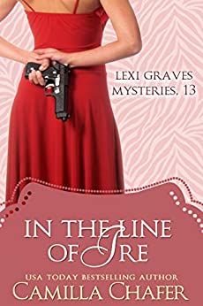 In the Line of Ire (Lexi Graves Mysteries Book 13) by [Camilla Chafer]