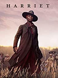 Harriet Movie cover with african american woman standing in field
