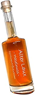Alter Laux Haselnuss -500ml- 40% Obstspirituose mit Haselnuss   in einer formschönen schrägen Flasche   mit Hand beschrieben