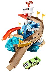 Speed down the ramp from the top of the tower, but try to avoid the chomping shark Hit the release lever to launch captured cars to safety Features two colour change zones, a dunk tank and splash pool Comes with a colour shifters car, includes only o...