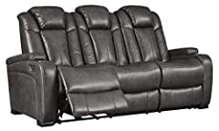 POWER RECLINING SOFA: Recline in this sofa with one touch power control and get double the relaxation with power adjustable headrests; Create a home theater experience right in your living room COMFY YET SLEEK: This power reclining sofa is wrapped in...