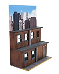 "NECA's street scene diorama sized to work with most 6"" - 9"" action figures Measures over 2 feet wide, over 18 inches tall and over a foot deep Displays more than 30 figures at once Features: 3 levels, clear window panels and full color cardboard back..."