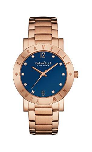 Reloj de Cuarzo de la Marca Caravelle, Modelo New York. para Mujer, con Esfera analógica de Color Azul y Pulsera de Oro Rosa, 44L202