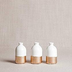 white and gold porcelain bud vases