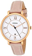 Round rose gold-tone watch with grooved white dial featuring Roman numerals at quarter hours and date indicator at 6 o'clock 36 mm stainless steel case with mineral dial window Quartz movement with analog display Leather band with buckle closure Wate...
