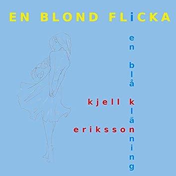 En blond flicka i en blå klänning