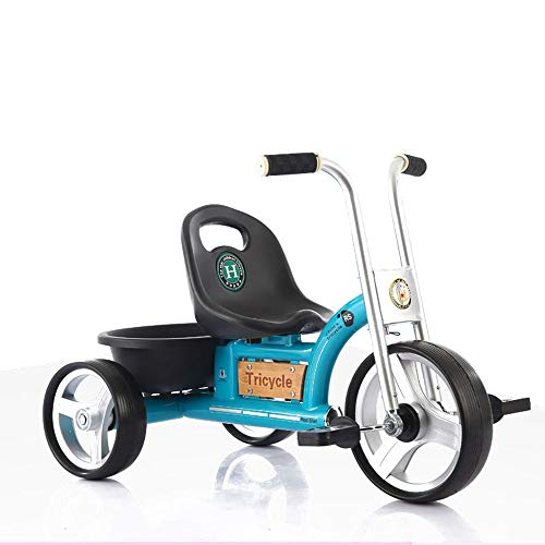 Triciclo de ciclismo antiguo, bicicleta para niños al aire