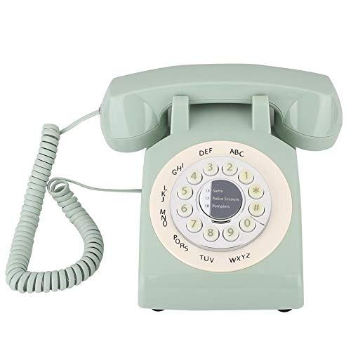Oude vaste telefoon in vintage stijl, traditionele bel, klassieke roterende telefoon, ouderwetse vaste telefoon (groen)