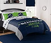 """NFL Seahawks """"Monument"""" Full/Queen Comforter #887166350 Officially licensed - 100 percent polyester - Machine washable Size: Full/Queen Comforter 86"""" x 86"""" (Sheet set sold separately) Features team logo in the center of the comforter, with the team n..."""