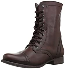 Distressed leather combat boot featuring full-length instep zipper and lace-up shaft Man-made or leather lining. Cap toe. Lightly cushioned leather footbed