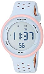 Light pink resin case; LCD display with time, seconds, day and date; light blue and tan double injected silicone strap with buckle closure Functions include: chronograph, lap time, alarm, military time and backlight with three second delay Quartz Mov...