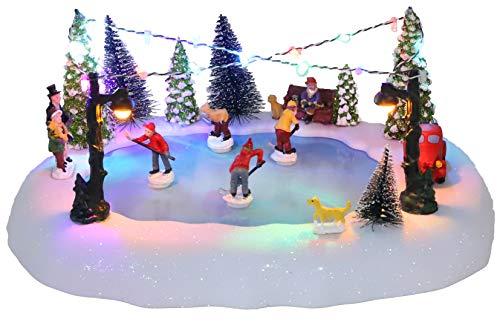 Christmas Concepts® 30 cm batteriebetriebene Musik-LED-Eisbahn-Dorf-Szene – spielt 8 Weihnachtsmelodien