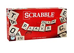 Scrabble word board game box with tiles with letters
