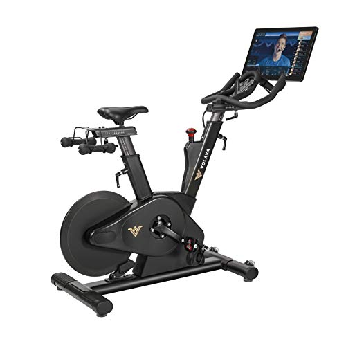 VOLAVA Bicicleta estática de alta gama que incluye 1 año de suscripción a clases virtuales. Muy robusta, elegante y silenciosa. Transmisión por correa. Freno Magnético. Uso doméstico, negro