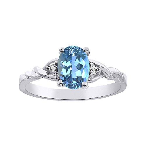 Juego de anillos de topacio azul y diamante en oro blanco solitario de 14 quilates