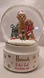 """Harrods """"Baby's first Christmas 2020"""" Snow globe Featuring cute puppy dogs dressed for the snow Wind-up plays a melodic rendition of Silent Night Resin; Glass H15cm x W10cm x D10cm approx."""