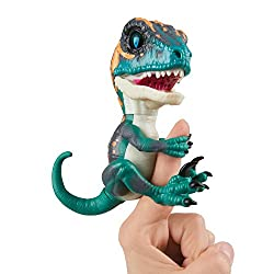 Fury is my name. I'm fast and furious - Tame me if you dare! Reacts to sound, motion, and touch Wild roars, chomping jaws, and even a little dino gas Grips onto your finger and fiercely loyal Batteries included; Additional colors sold separately