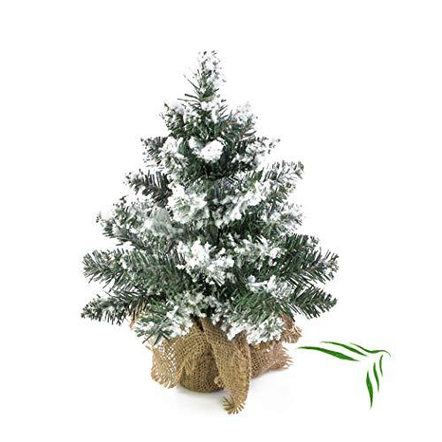 artplants.de Künstlicher Mini Weihnachtsbaum Reykjavik im braunen Dekosack, beschneit, 38 Zweige, 30cm, Ø 18cm - Kunst Tannenbaum - Deko Christbaum