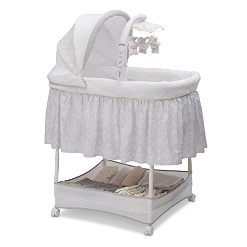Simmons Kids Gliding Bedside Bassinet - Portable Crib with Activity Mobile Arm Featuring Spinning Toys, Vibration, Nightlight and Music, Peacock