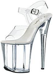Towering platform dress sandal in allover see-through materials with white padded footbed Adjustable silver-tone buckle at ankle