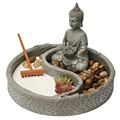 """Colour: Multi-color Size: 6 x 6 (inch) This Tabletop Zen Garden come with pieces: a Base, Rocks, a bag of Sand, a Rake, a Lotus and a 4"""" Buddha statue . Use this table top Mini Zen Garden to aide in meditation sessions and to create a peaceful energy..."""