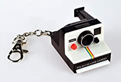 This miniature Polaroid camera is a replica of the original (but it does not take photos). Features sound, simulated film and a clickable red shutter button. Clip the camera to your backpack or Keychain and say cheese!