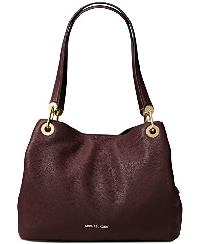 Raven shoulder bag is a stylish, wear-everywhere accessory. In supple pebbled leather, it boasts generous top handles and high-shine hardware. Its spacious design renders it a practical and polished counterpart to day and night looks. Crafted with Ba...