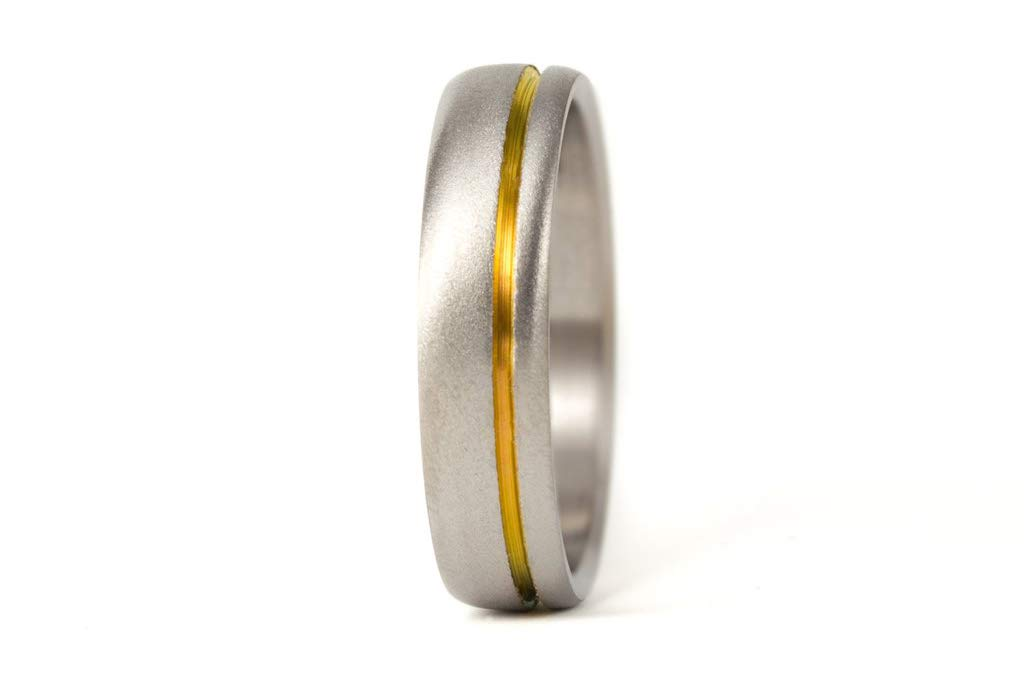Very popular Women's sandblasted titanium ring with anodized golden Mo inlay. Tulsa Mall