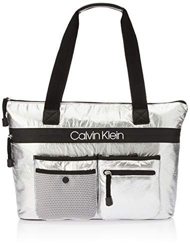 Bring sporty style to your look with this Calvin Klein® Tabbie Reflective Nylon Tote. Shimmery metallic nylon construction featuring a front logo detail. Zipper closure. Dual handles. Four exterior zip pockets.  Single snap pocket at the front.  Two ...