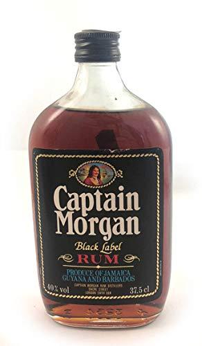 Captain Morgan Black Label Jamaica Rum 1980's (37.5cl) in einer mit Seide ausgestatetten Geschenkbox. Da zu vier Wein Zubehör, Korkenzieher, Giesser, Kapselabschneider,Weinthermometer, 1 x 700ml