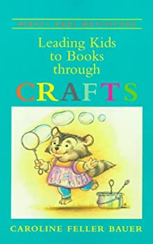 Paperback Leading Kids to Books Through Crafts Book