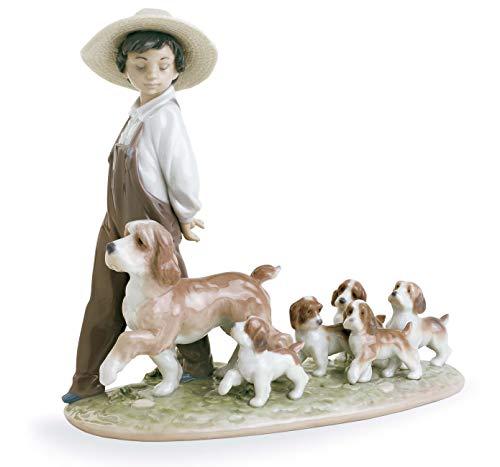 LLADRÓ My Little Explorers Boy with Dogs Figurine. Porcelain Boy Figure.