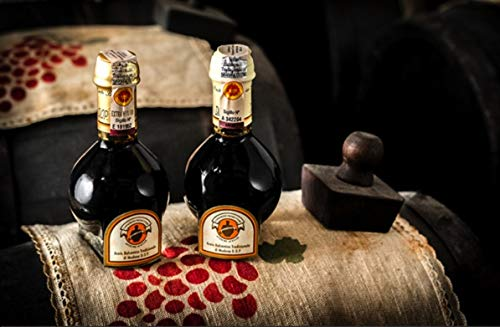 25 Year Aged Extravecchio Traditional Balsamic Vinegar of Modena D.O.P. | Original Aged Artisanal Italian Aceto… 3 SUPERIOR QUALITY BALSAMIC VINEGAR IMPORTED FROM ITALY. The ageing process is prolonged for 25 years to give the product a strong personality, able to exalt any dish with just a few drops. TESTED AND VALIDATED BY THE EXPERTS OF THE CONSORTIUM FOR THE PROTECTION OF TRADITIONAL BALSAMIC VINEGAR BEFORE BEING BOTTLED. Obtained by traditional methods from Trebbiano and Lambrusco grapes grown in the Modena area in a long ageing process in barrels of different wood kinds: oak, chestnut, cherry, juniper and mulberry. Human sensibility and expertise allow to measure out the ageing process in a balanced way to obtain a superior quality product AGING PROCESS. Traditional Balsamic Vinegar of Modena 25 years is obtained from cooked grape must, matured by slow acidification through natural fermentation and progressive concentration in a long ageing process in barrels of different wood kinds, without adding any flavors.