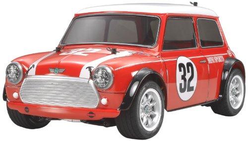 Tamiya 300058438 - Mini Cooper Racing radiocomandata, in scala 1:10, confezione con modellino e motore elettrico