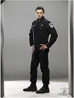 SGU Stargate Universe 8 Inch x10 Inch Photo Lou Diamond Phillips Grey Uniform Full Body Hands on Hips Light Grey Background kn