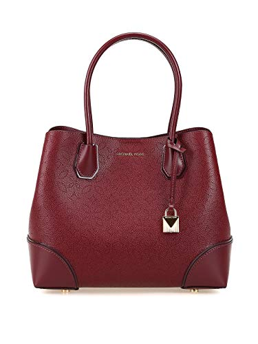 Michael Kors leather tote bag with laser-cut detail. Michael Kors leather tote bag with laser-cut detail. Removable, adjustable shoulder strap. Open top with center snap closure.