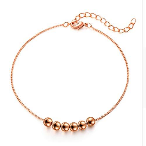 Braccialetto a catena in stile minimalista con piccole sfere in oro rosa 18 K, di alta qualità.