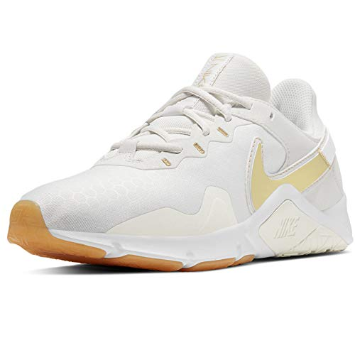 Nike Wmns Legend Essential 2 - Scarpe da Ginnastica da Donna, (Platinum Tint Mtlc Gold Star), 39 EU