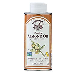 ALMOND OIL FOR COOKING IN YELLOW AND WHITE CONTAINER