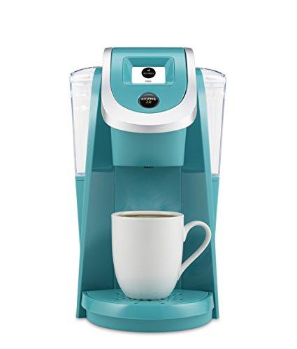 a turquoise keurig machine