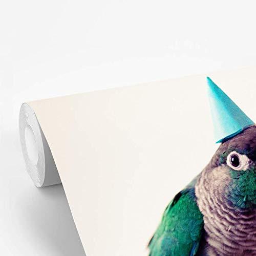 Fotobehang vinyl Parkieten - Turquoise parkiet met een feesthoedje op zit op een vinger 450x300 cm