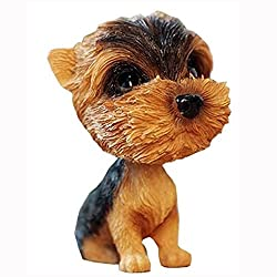 """This tiny 4.7"""" x 2.3"""" Yorkie bobblehead is proof that they never go out of style. So, bring joy to everyone's day by having a tiny bobbing Yorkie head on ..."""