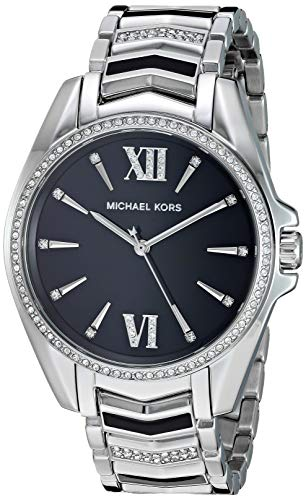 Michael Kors' Whitney 38mm watch features a black glossy dial with silver stick and Roman numeral indexes, three-hand Movement and stainless steel bracelet with glitz and black enamel center links 38mm case, 18mm band width, mineral crystal, Quartz m...